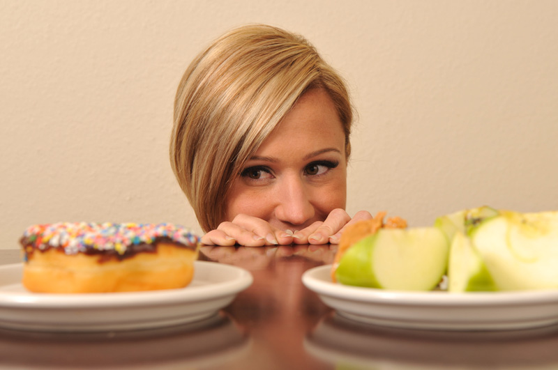 Write a headline to temp the reader to reader, like this woman in the photo is tempted to eat.